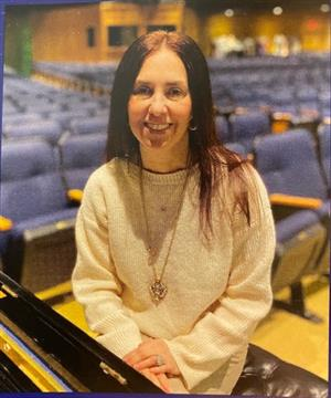 Mrs. Driscole Music teacher in auditorium